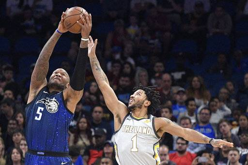 Orlando Magic forward Marreese Speights (5) grabs a pass in front of Cleveland Cavaliers guard Derrick Rose (1) during the first half of NBA basketball game Tuesday, Feb. 6, 2018, in Orlando, Fla.