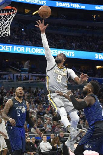 Cleveland Cavaliers guard Dwyane Wade (9) puts up a shot between Orlando Magic forward Marreese Speights (5) and guard Shelvin Mack (7) during the first half of NBA basketball game Tuesday, Feb. 6, 2018, in Orlando, Fla.