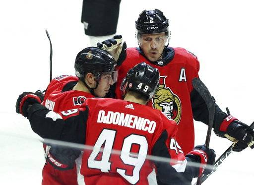Ottawa Senators Christopher DiDomenico (49) celebrates his goal with teammates Jean-Gabriel Pageau (44) and Dion Phaneuf (2) during the first period of an NHL hockey game Tuesday, Feb. 6, 2018, in Ottawa, Ontario. (Fred Chartrand/The Canadian Press via AP)