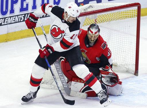 New Jersey Devils Brian Boyle (11) attempts to screen Ottawa Senators goaltender Craig Anderson (41) during the second period of an NHL hockey game Tuesday, Feb. 6, 2018, in Ottawa, Ontario. (Fred Chartrand/The Canadian Press via AP)