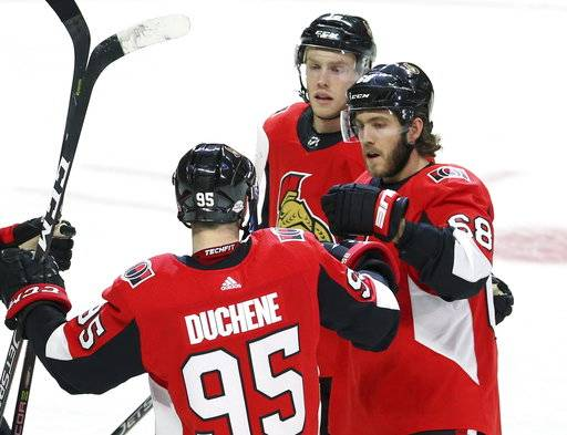 Ottawa Senators Mike Hoffman (68) celebrates his goal with teammates Matt Duchene (95) and Ryan Dzingel (18) during the first period of an NHL hockey game Tuesday, Feb. 6, 2018, in Ottawa, Ontario. (Fred Chartrand/The Canadian Press via AP)