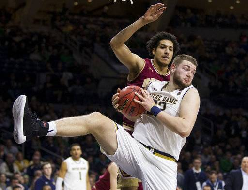 Notre Dame's Martinas Geben (23) comes down with a rebound in front of Boston College's Johncarlos Reyes during the second half of an NCAA college basketball game Tuesday, Feb. 6, 2018, in South Bend, Ind. Notre Dame won 96-85.