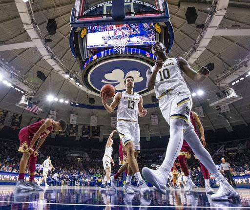 Notre Dame's Temple Gibbs Jr. (10) celebrates making a first-half buzzer beater with Nikola Djogo (13) during the team's NCAA college basketball game against Boston College in South Bend, Ind., Tuesday, Feb. 6, 2018. (Michael Caterina/South Bend Tribune via AP)via AP)