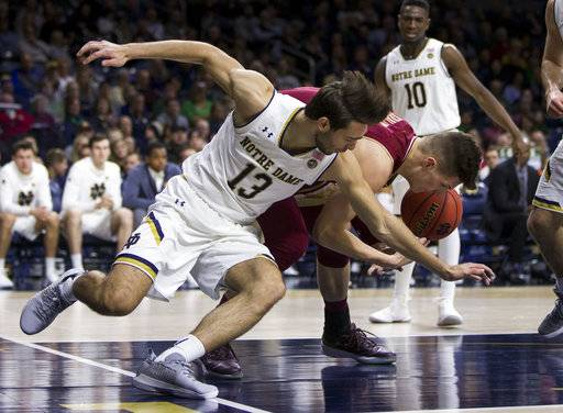 Notre Dame's Nikola Djogo (13) competes for a loose ball with Boston College's Luka Kraljevic during the first half of an NCAA college basketball game Tuesday, Feb. 6, 2018, in South Bend, Ind.