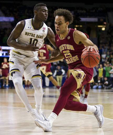 Boston College's Jordan Chatman (25) drives as Notre Dame's T.J. Gibbs (10) defends during the first half of an NCAA college basketball game Tuesday, Feb. 6, 2018, in South Bend, Ind.
