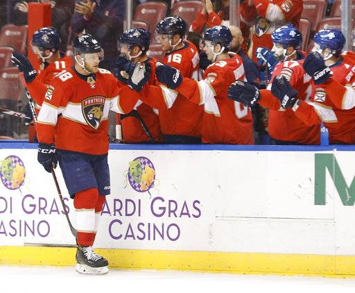 Florida Panthers left wing Jamie McGinn (88) is congratulated by teammates after he scored during the first period of an NHL hockey game against the Vancouver Canucks, Tuesday, Feb. 6, 2018, in Sunrise, Fla.