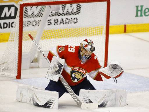 Florida Panthers goaltender Harri Sateri blocks a shot during the second period of the team's NHL hockey game against the Vancouver Canucks, Tuesday, Feb. 6, 2018, in Sunrise, Fla. The Panthers defeated the Canucks 3-1.