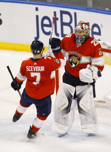 Florida Panthers center Colton Sceviour (7) congratulates goaltender Harri Sateri (29) after the Panthers defeated the Vancouver Canucks 3-1 during an NHL hockey game, Tuesday, Feb. 6, 2018, in Sunrise, Fla.