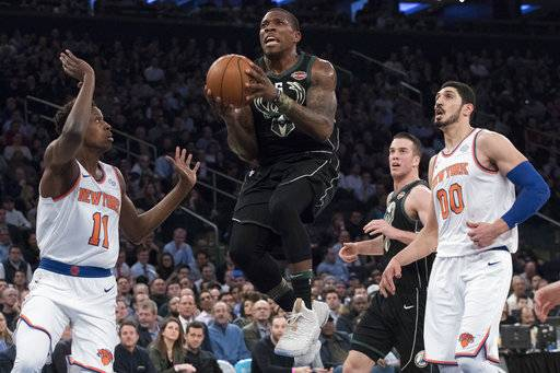 Milwaukee Bucks guard Eric Bledsoe (6) goes to the basket past New York Knicks guard Frank Ntilikina (11) and center Enes Kanter (00) during the first half of an NBA basketball game Tuesday, Feb. 6, 2018, at Madison Square Garden in New York.