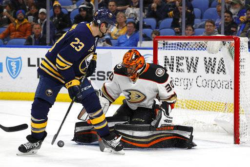Buffalo Sabres forward Sam Reinhart (23) is stopped by Anaheim Ducks goalie Ryan Miller (30) during the first period of an NHL hockey game, Tuesday, Feb. 6, 2018, in Buffalo, N.Y.