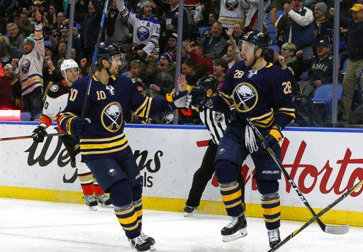 Buffalo Sabres Zemgus Girgensons (28) celebrates his goal with Jacob Josefson (10) during the first period of an NHL hockey game against the Anaheim Ducks, Tuesday, Feb. 6, 2018, in Buffalo, N.Y.