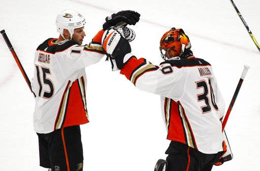 Anaheim Ducks Ryan Getzlaf (15) and Ryn Miller (30) celebrate a 4-3 victory over the Buffalo Sabres following the overtime period of an NHL hockey game, Tuesday, Feb. 6, 2018, in Buffalo, N.Y.
