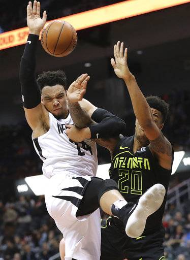 Atlanta Hawks' John Collins, right, and Memphis Grizzlies' Dillon Brooks vie for the ball under the basket during the second half of an NBA basketball game Tuesday, Feb 6, 2018, in Atlanta. (Curtis Compton/Atlanta Journal-Constitution via AP)