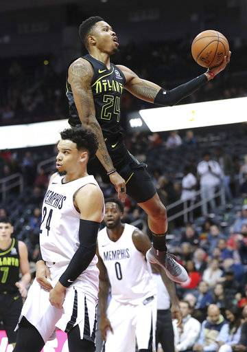 Atlanta Hawks' Kent Bazemore goes to the basket past Memphis Grizzlies Dillon Brooks during the first half of an NBA basketball game, Tuesday, Feb. 6, 2018 in Atlanta. (Curtis Compton /Atlanta Journal-Constitution via AP)