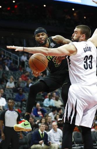 Atlanta Hawks guard Malcolm Delaney (5) drives against Memphis Grizzlies center Marc Gasol (33) in the first half of an NBA basketball game Tuesday, Feb. 6, 2018, in Atlanta.