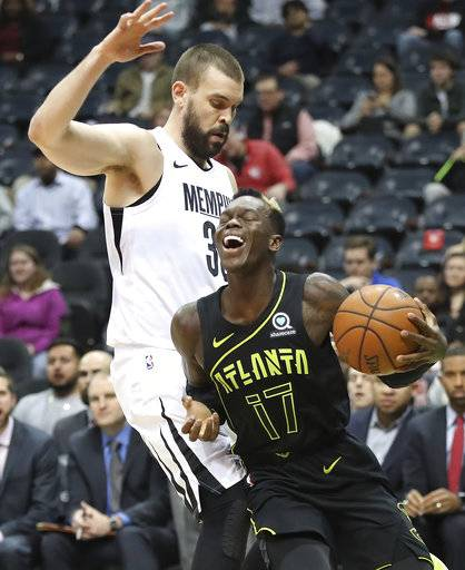 Atlanta Hawks Dennis Schroder is fouled by Memphis Grizzlies Marc Gasol during an NBA basketball game, Tuesday, Feb. 6, 2018 in Atlanta. (Curtis Compton/Atlanta Journal-Constitution via AP)