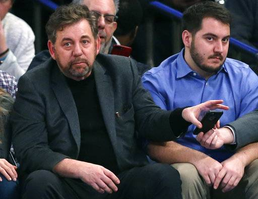 FILE - This Jan. 9, 2017 file photo shows New York Knicks owner James Dolan taking his cell phone from an assistant during the second half of an NBA basketball game between the New York Knicks and the New Orleans Pelicans at Madison Square Garden in New York. The New York Liberty are remaining under the control of Dolan and Madison Square Garden for now. The WNBA team was put up for sale in November. An MSG executive confirmed to The Associated Press on Tuesday, Feb. 6, 2018 that Dolan's group has decided to keep the Liberty at this time.