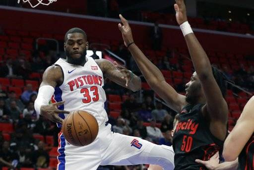 Detroit Pistons center Willie Reed (33) grabs a rebound as Portland Trail Blazers forward Caleb Swanigan (50) defends during the second half of an NBA basketball game, Monday, Feb. 5, 2018, in Detroit.