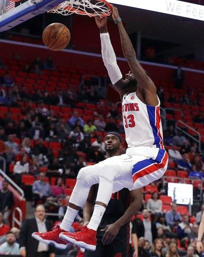 Detroit Pistons center Willie Reed dunks during the second half of an NBA basketball game against the Portland Trail Blazers, Monday, Feb. 5, 2018, in Detroit.