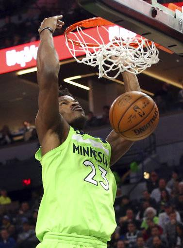 Minnesota Timberwolves' Jimmy Butler dunks against the New Orleans Pelicans in the first half of an NBA basketball game Saturday, Feb. 3, 2018, in Minneapolis.