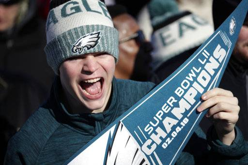 A Philadelphia Eagles fan chants while waiting for the team to arrive at Philadelphia International Airport a day after defeating the New England Patriots in Super Bowl 52 in Minneapolis, Monday, Feb. 5, 2018.