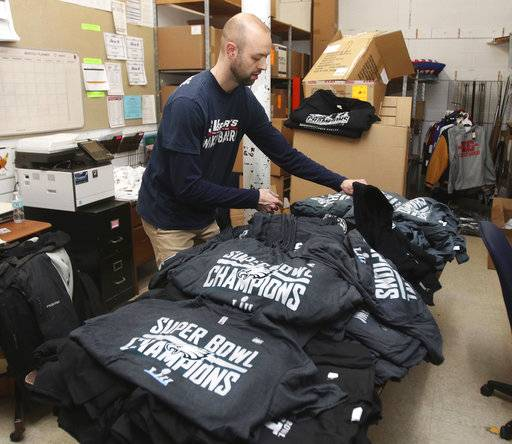 Staffer Matt Camella, of Schuylkill Valley Sports, sorts a shipment of newly arrived Philadelphia Eagles Super Bowl championship shirts at their Wyoming Valley Mall location, Monday, Feb. 5, 2018, in Wilkes Barre Township, Pa. The shirts will go on sale Tuesday along with other championship merchandise. (Dave Scherbenco/The Citizens' Voice via AP)