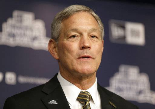 FILE - In a Dec. 5, 2017 file photo, University of Iowa NCAA college football head coach Kirk Ferentz speaks to reporters during a news conference in New York. Attorneys for Iowa football coach Kirk Ferentz and his neighbors say they've settled a dispute over a private road and the coach's refusal to join a homeowner's association. A trial was scheduled to start Tuesday, Feb. 6, 2018, in the dispute that pitted Iowa's highest-paid public employee and his wife against the three other families who live on Saddle Club Road outside Iowa City.