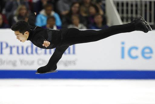 FILE - In this Saturday, Jan. 6, 2018, file photo, Nathan Chen performs during the men's free skate event at the U.S. Figure Skating Championships in San Jose, Calif. As olympic figure skaters head to the Pyeongchang Olympics, the men who will compete for medals know what the deciding factor will be: that four-revolution jump, and how many you land. Two-time U.S. champion Chen plans five in his free skate.