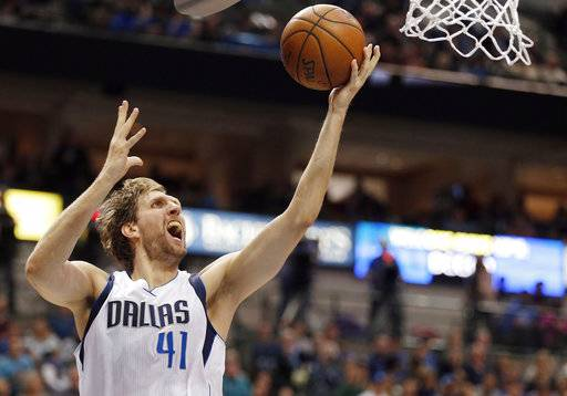 FILE - In this March 20, 2016, file photo, Dallas Mavericks forward Dirk Nowitzki (41) attempts a layup during the second half of an NBA basketball game against the Portland Trail Blazers in Dallas. Now in his 20th season, Nowitzki is comfortable with the idea that he led the Mavericks to their first championship and can try to help a younger core build toward making Dallas a title contender again.