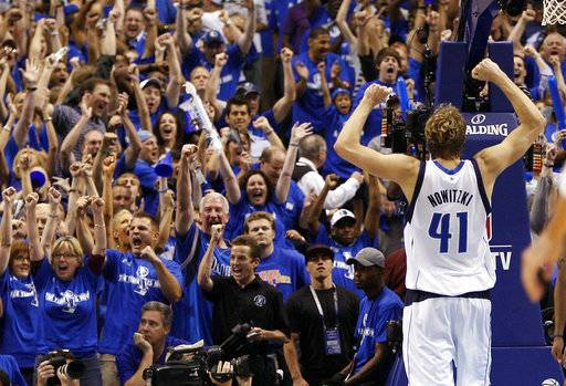 FILE - In this May 25, 2011, file photo, Dallas Mavericks forward Dirk Nowitzki (41), of Germany, holds up his arms as fans cheer during the final seconds of Game 5 of the NBA basketball Western Conference finals against the Oklahoma City Thunder in Dallas. Now in his 20th season, Nowitzki is comfortable with the idea that he led the Mavericks to their first championship and can try to help a younger core build toward making Dallas a title contender again.