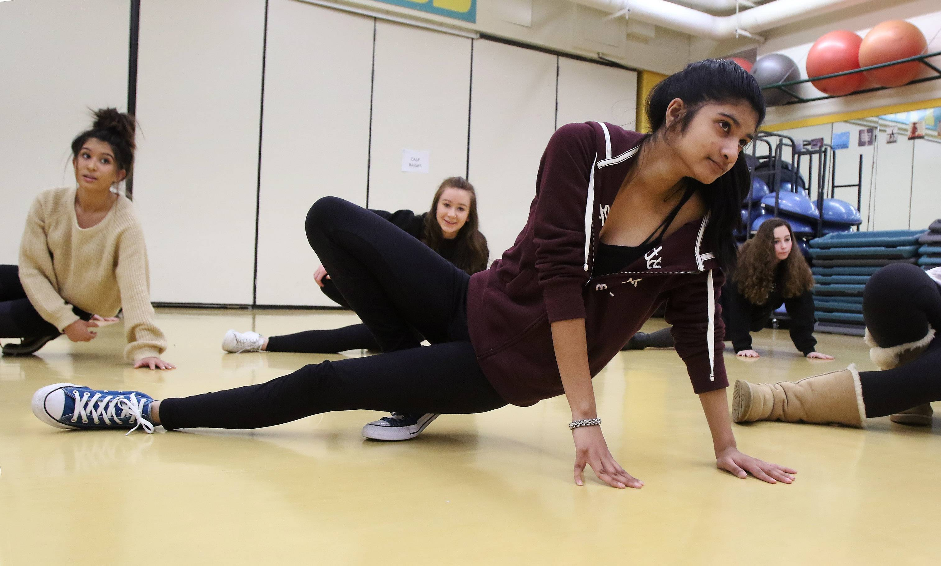 Stevenson High School sophomore Suma Pasupulati practices a move in breakdancing class during the Odyssey fine arts festival Wednesday.