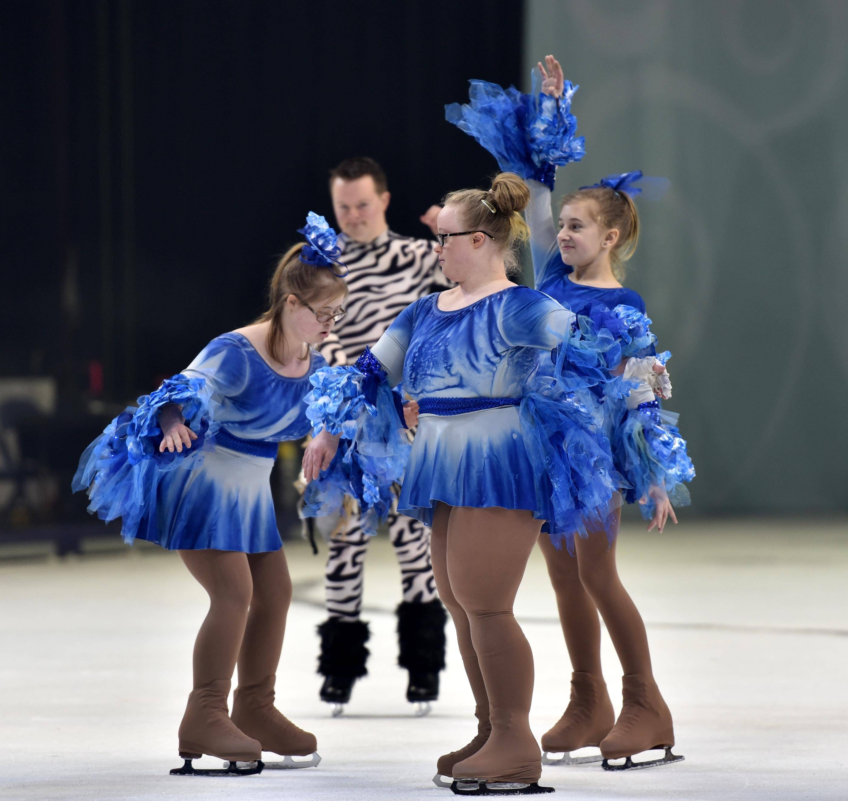 "Carlie Reuter, foreground, of Woodstock, and fellow skaters Abby Stanton, 18, left, of Lake in the Hills and her sister Isabelle, 11, as well as Ben Collins, background, of Crystal Lake, perform during their own presentation to the stars of the cast of Disney On Ice ""Dare To Dream"" at the Allstate Arena Friday, Jan. 26. The former Special Olympians now skate together with the Chicagoland Ice Theatre Inspirations."