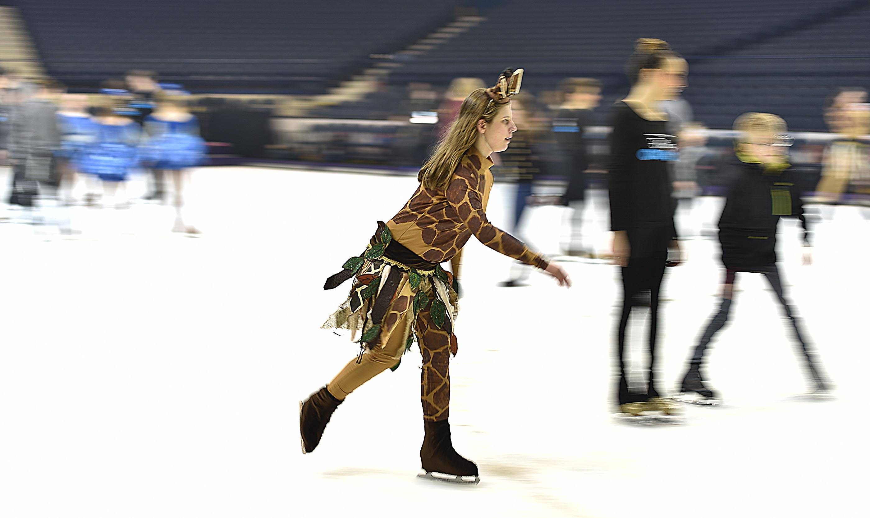 Brianna Hansen of Crystal Lake makes loops around the ice as former Special Olympians from Chicagoland Ice Theatre Inspirations meet the cast of Disney On Ice at the Allstate Arena last week.