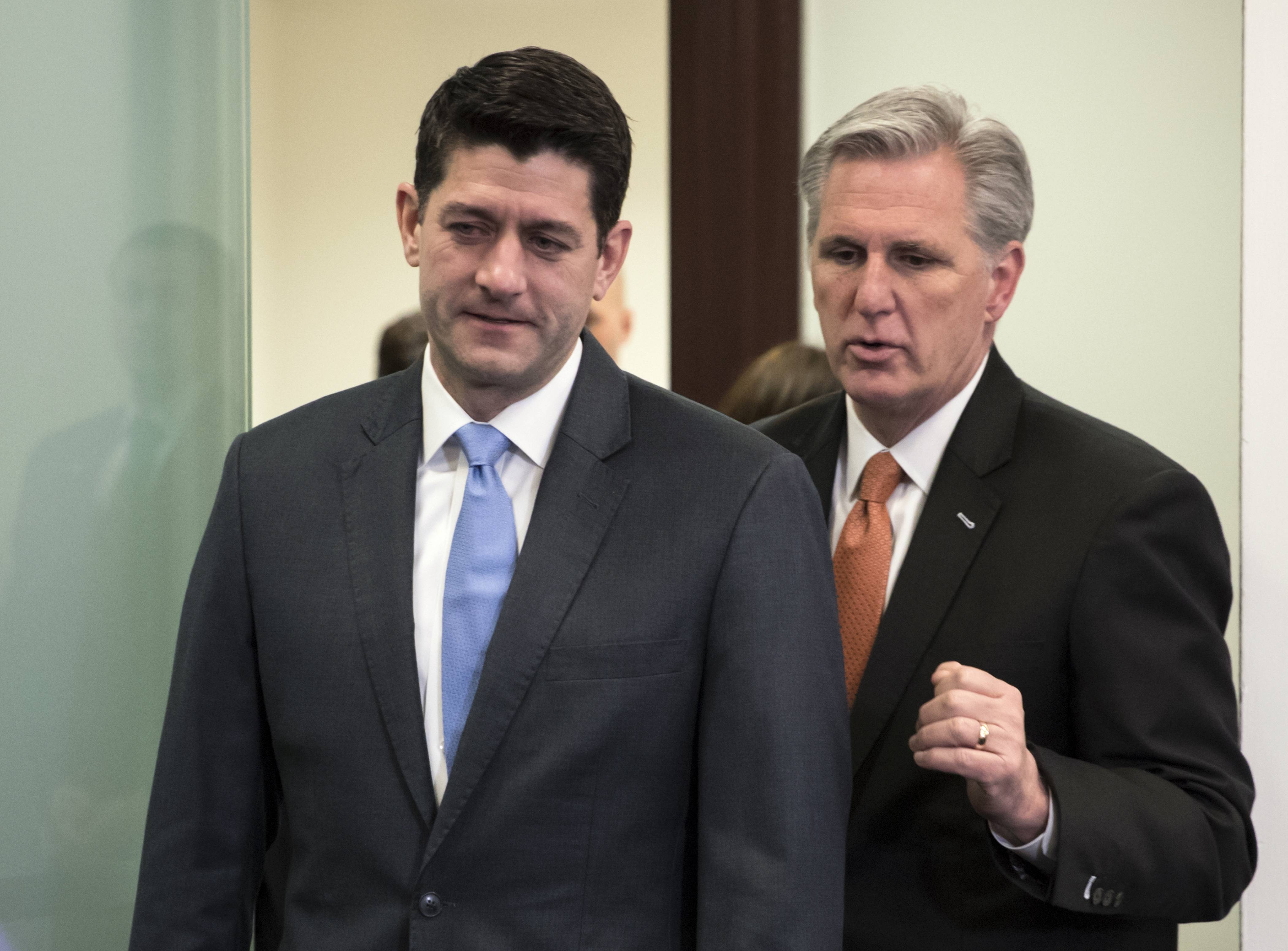Speaker of the House Paul Ryan, R-Wis., left, and Majority Leader Kevin McCarthy, R-Calif., confer as they arrive to meet with reporters following a closed-door GOP strategy session at the Capitol in Washington, Tuesday, Feb. 6, 2018. The GOP-controlled House is slated Tuesday to pass a plan to keep the government open for six more weeks while Washington grapples with a potential follow-up budget pact and, perhaps, immigration legislation.