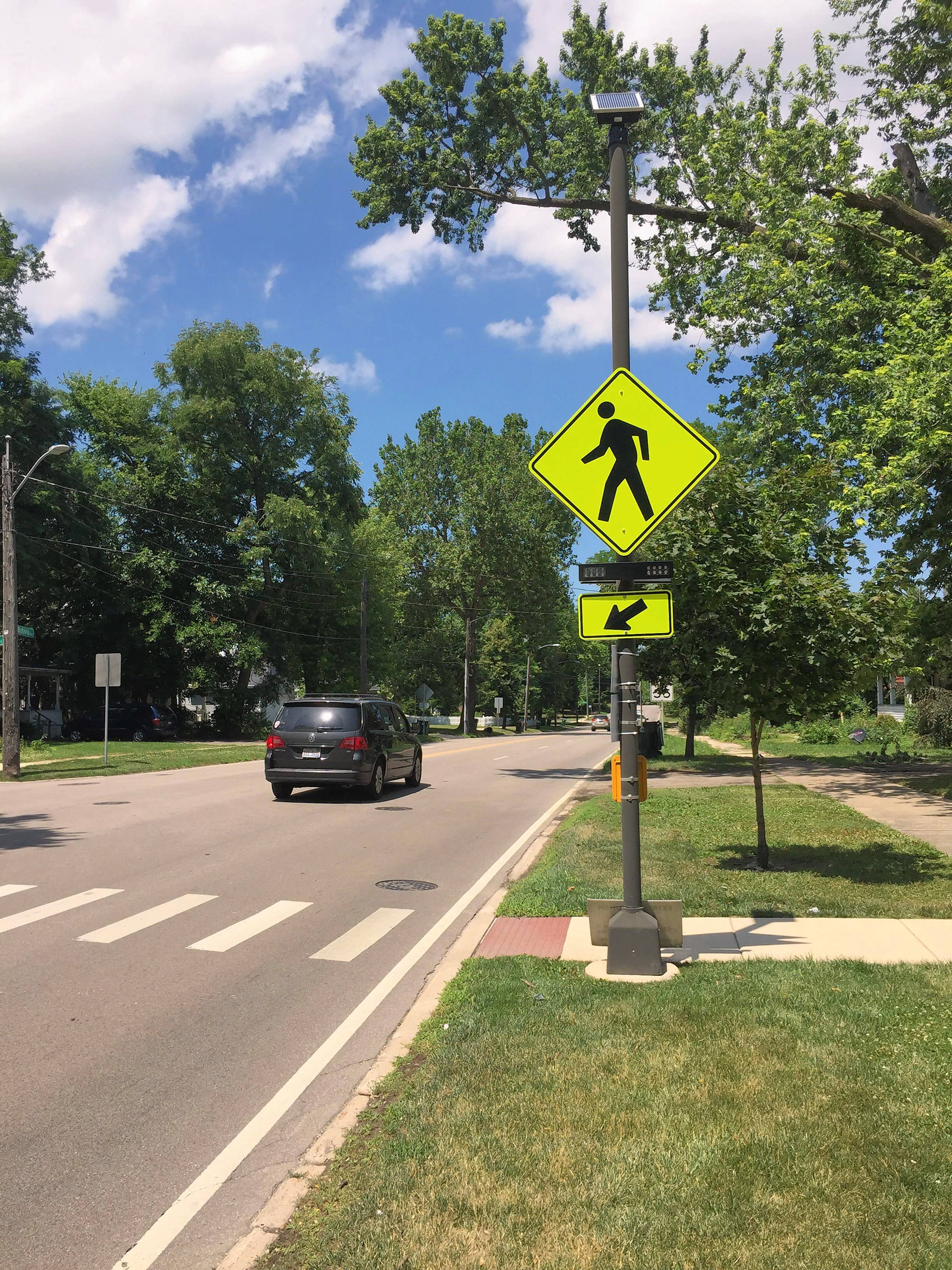 The rectangular rapid flashing beacon for a pedestrian crossing at McKee Street on Route 31 in Batavia. It was damaged in a car crash Sunday night, and federal rules prohibit replacing or repairing it.