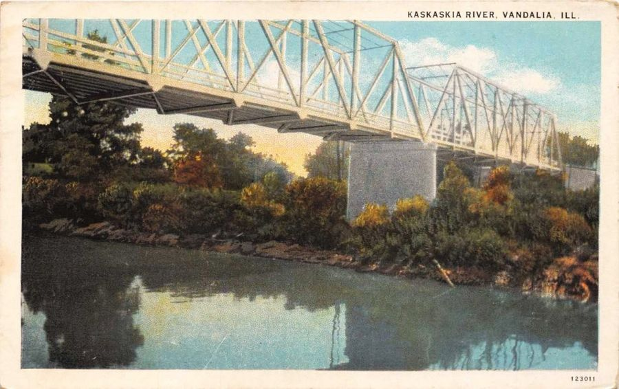 A postcard view of the steel truss structure that originally topped a bridge over the Kaskaskia River in Vandalia. In 1962, the truss was moved to Rockland Road over the Des Plaines River in Libertyville.