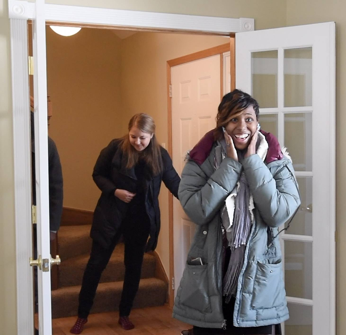 U.S. Navy veteran Shynae Murphy walks into her newly renovated, mortgage-free home in Algonquin for the first time Tuesday. She was awarded the house through a program offered by Operation Homefront and JPMorgan Chase.