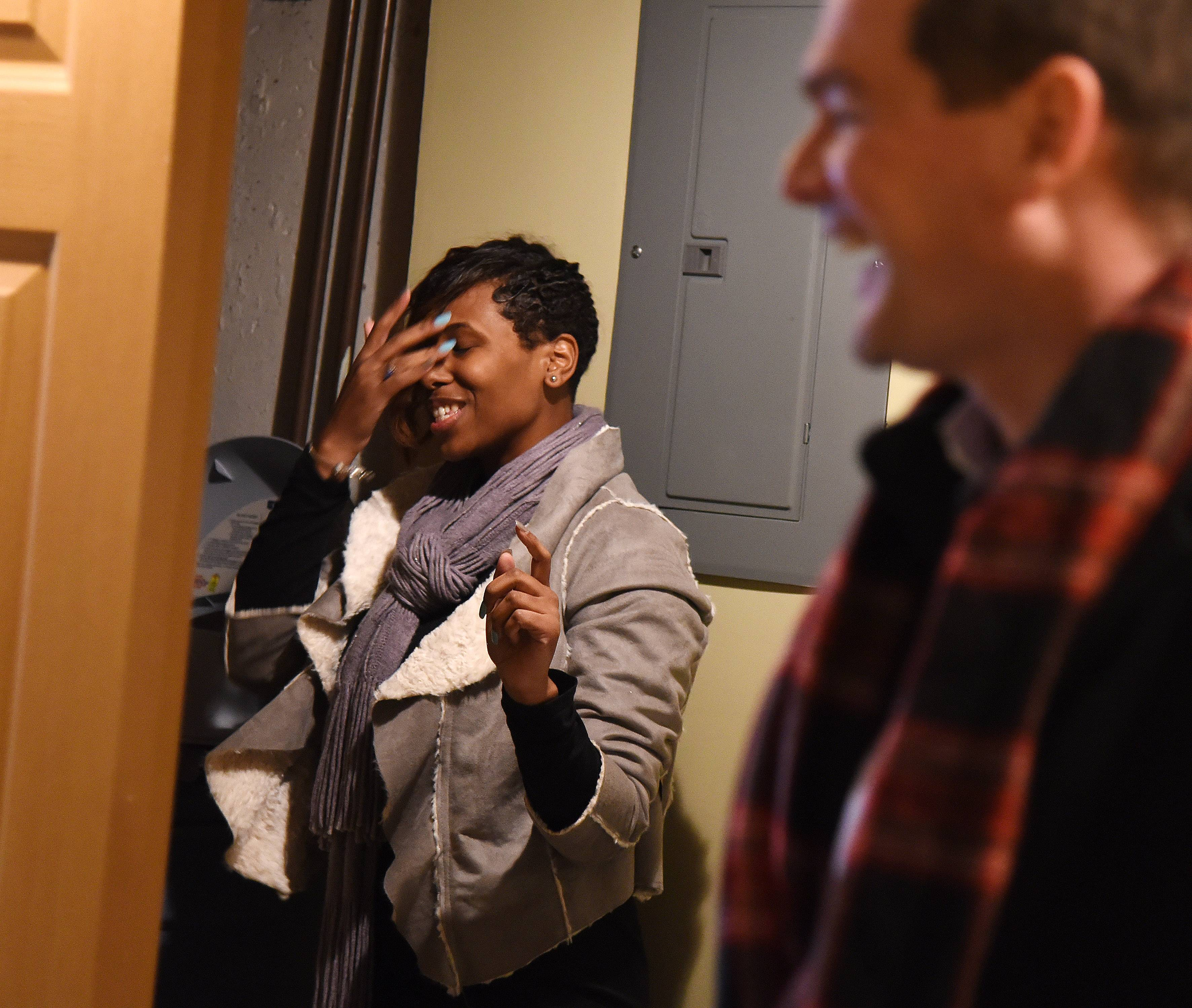 U.S. Navy veteran Shynae Murphy is overwhelmed by the finished basement in her newly renovated home, which was awarded to her by Operation Homefront and JPMorgan Chase.