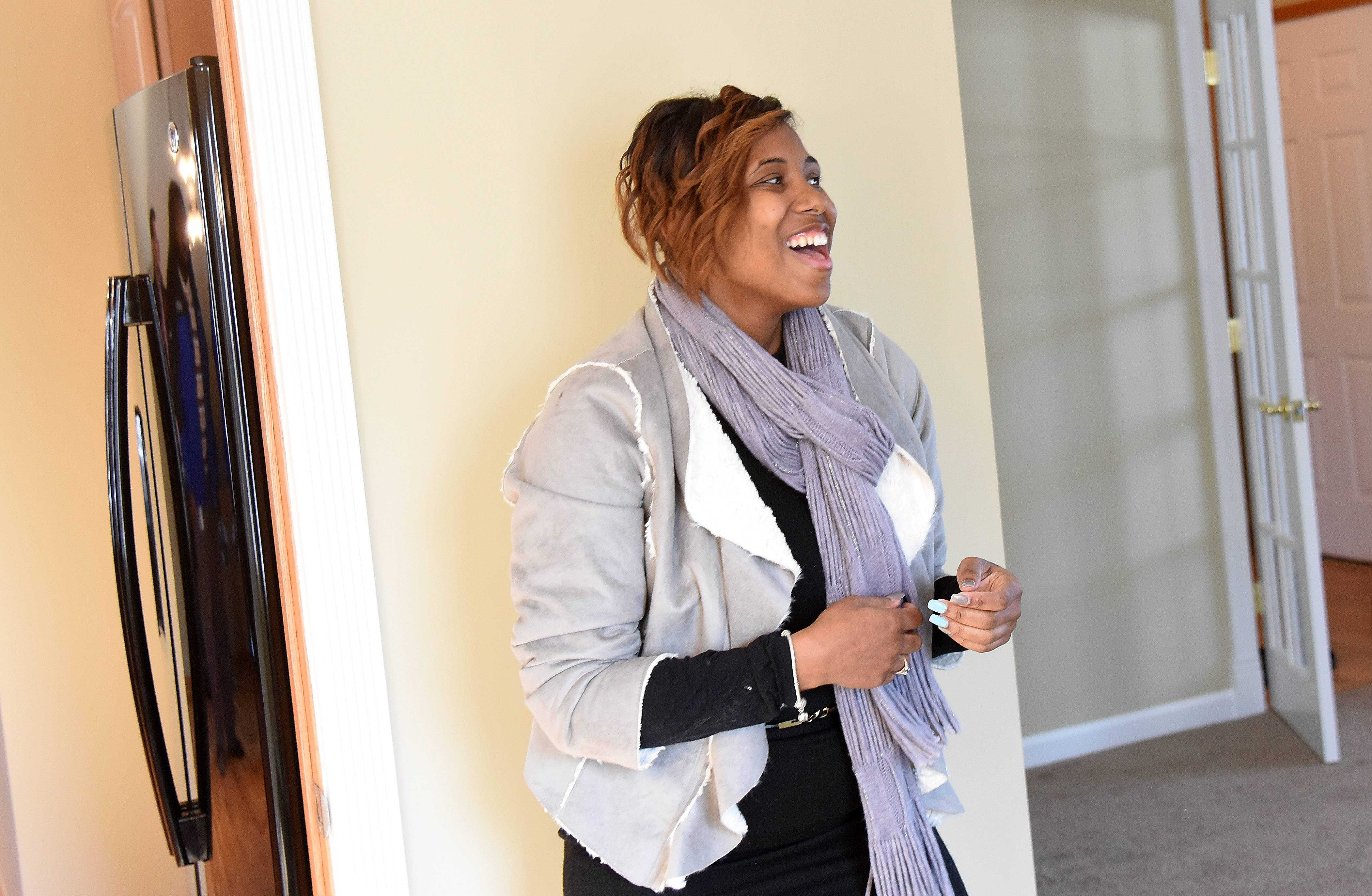 U.S. Navy veteran Shynae Murphy tours her newly renovated home in Algonquin for the first time Tuesday.