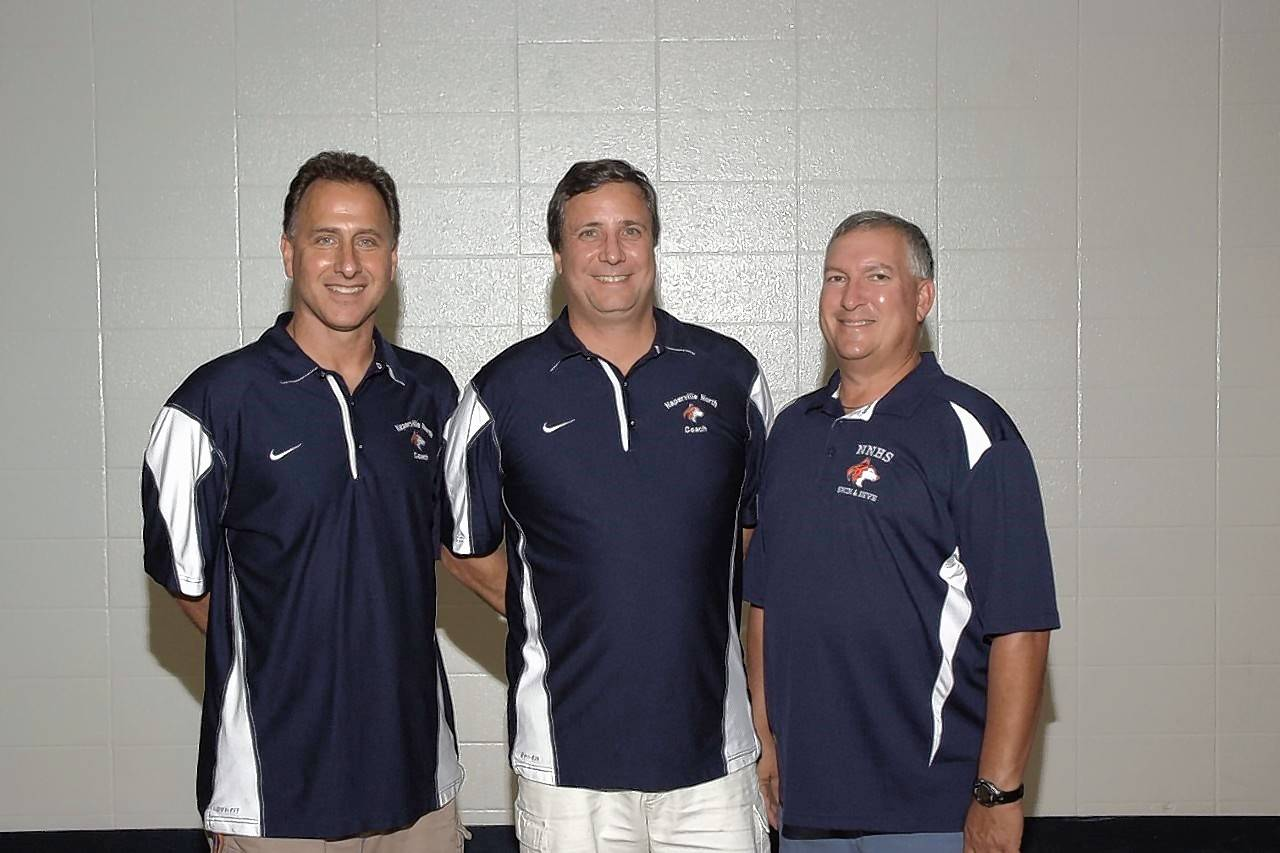 From left, former Naperville North diving coach Steve Mazzarella, current swim/dive coach Andy McWhirter and former coach Lew Kasten.
