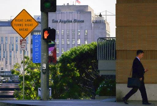 The Los Angeles Times building is seen in downtown Los Angeles on Wednesday, Feb. 7, 2018. Dr. Patrick Soon-Shiong, a biotech billionaire, struck a $500 million deal Wednesday to buy the Los Angeles Times, ending the paper's quarrelsome relationship with its Chicago-based corporate overseers and bringing it under local ownership for the first time in 18 years.