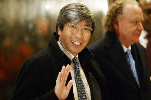 FILE - In this Jan. 10, 2017, file photo, pharmaceuticals billionaire Dr. Patrick Soon-Shiong waves as he arrives in the lobby of Trump Tower in New York for a meeting with President-elect Donald Trump. It was announced Wednesday, Feb. 7, 2018, that the Los Angeles Times is being sold to Soon-Shiong, a local billionaire, for $500 million, ending its strained tenure under the owner of the Chicago Tribune.