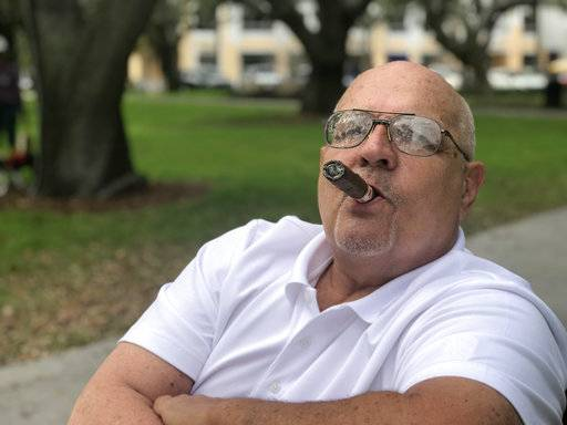 In this Tuesday, Feb. 6, 2018, photo, John Wall, 65, who semi-retired and keeps a part-time job with a rideshare app to help pay bills, talks about how he won't be able to retire in St. Petersburg, Fla. He lost money in his investments during Monday's dip in the stock market.