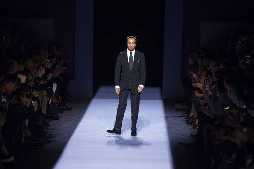 Designer Tom Ford salutes during his men's collection show at the Men's Fashion Week in New York, Tuesday, Feb. 6, 2018.