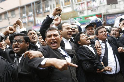 Supporters of Bangladesh Nationalist Party (BNP) shout slogans outside the court in Dhaka, Bangladesh, Thursday, Feb. 8, 2018. Bangladesh was on high alert ahead of a verdict Thursday against opposition leader and former Prime Minister Khaleda Zia in a politically sensitive corruption case.