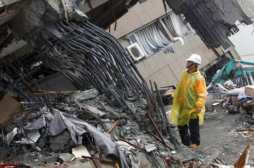 An official inspects the failed rebar foundation pillars during a continued search operation at an apartment building collapsed after a strong earthquake in Hualien County, eastern Taiwan, Thursday, Feb. 8, 2018. A magnitude 6.4 earthquake struck late Tuesday night caused several buildings to cave in and tilt dangerously.
