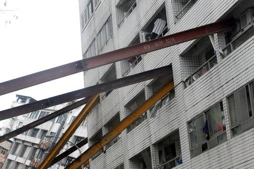 Several steel pillars support to an apartment building collapsed and leaning after a strong earthquake in Hualien County, eastern Taiwan, Thursday, Feb. 8, 2018. A magnitude 6.4 earthquake struck late Tuesday night caused several buildings to cave in and tilt dangerously.