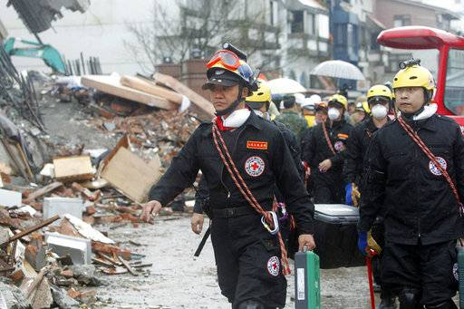 Rescuers work on a search operation at an apartment building collapsed after a strong earthquake in Hualien County, eastern Taiwan, Thursday, Feb. 8, 2018. A magnitude 6.4 earthquake struck late Tuesday night caused several buildings to cave in and tilt dangerously.