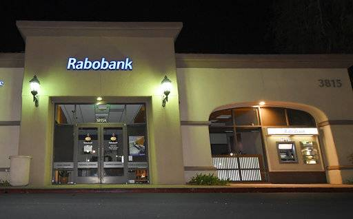 A Rabobank bank location is seen, Tuesday, Feb. 6, 2018, in Thousand Oaks, Calif. Dutch lender Rabobank's California subsidiary is scheduled to enter a plea a long-running investigation that led to allegations the bank was used to launder millions of dollars in Mexican drug money.