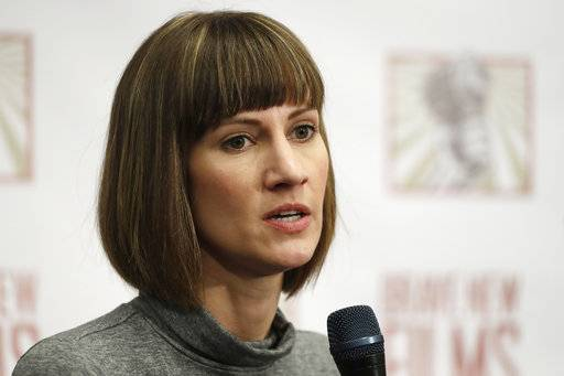 FILE - In this Dec. 11, 2017, file photo, Rachel Crooks, a university administrator and former Trump Tower receptionist, discusses her sexual misconduct accusations against Donald Trump during a news conference with two other accusers in New York. Crooks filed paperwork Monday, Feb. 5, 2018, to run for Ohio's state legislature as a Democrat in northwest Ohio's 88th House District near Toledo and Lake Erie. If Crooks wins the primary, the first-time candidate would face incumbent Republican Bill Reineke, a car dealer serving his second term in office.
